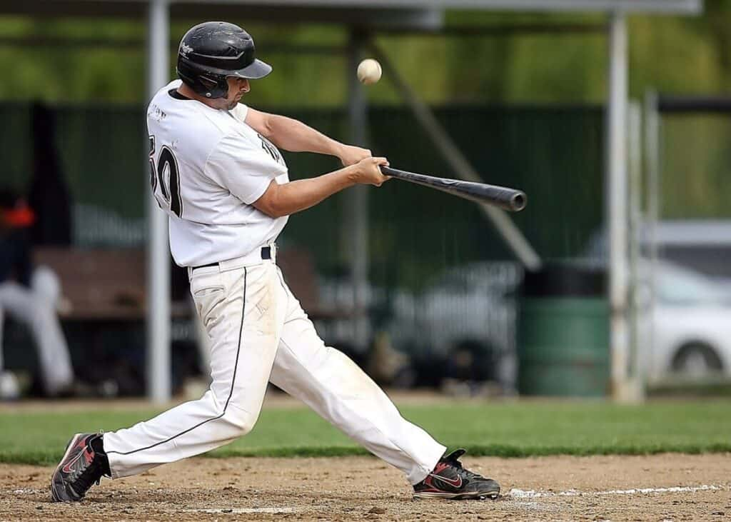 Player Swinging Baseball Bat