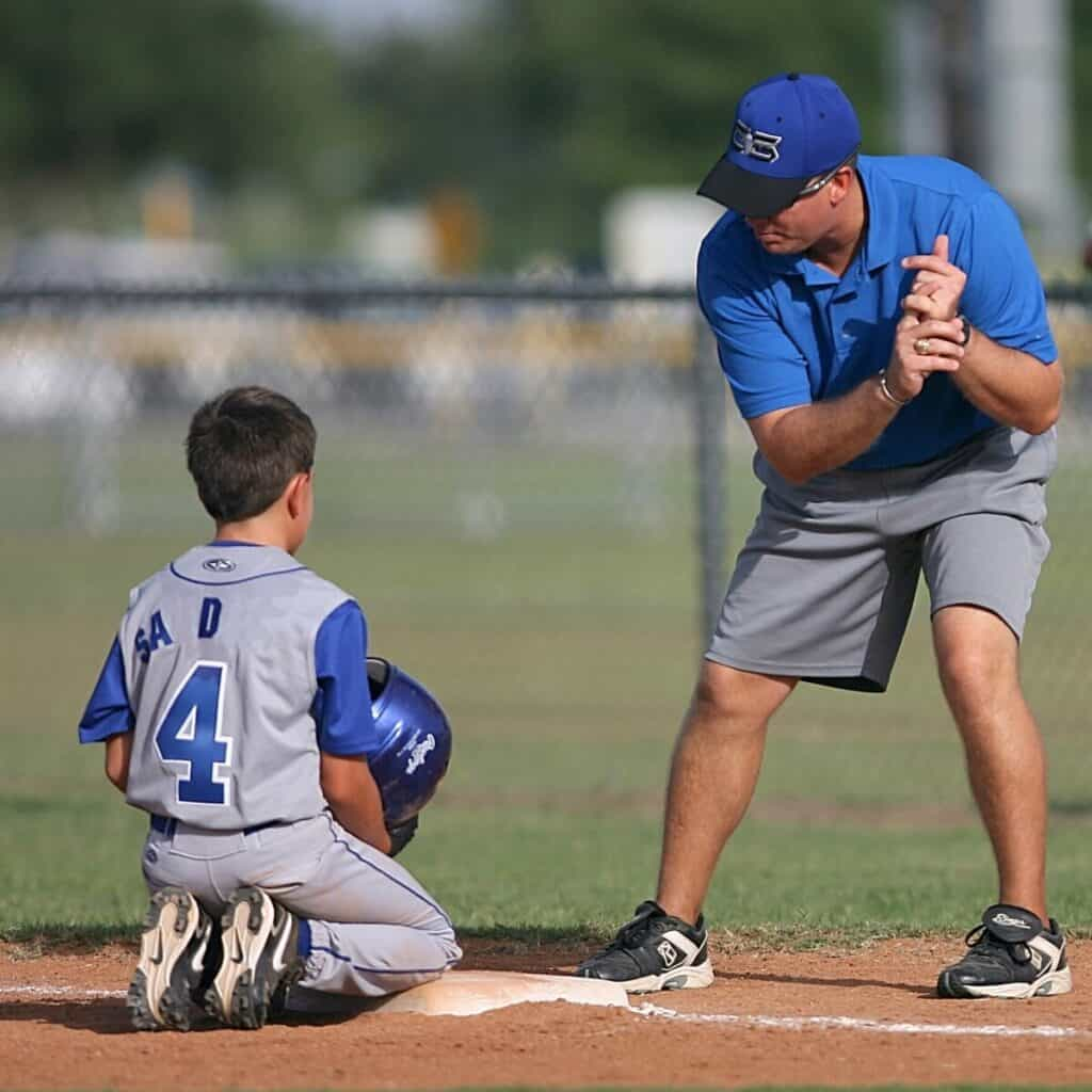 Baseball Coach Teaching Youth Player