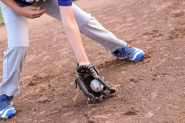 Baseball Player Fielding Baseball