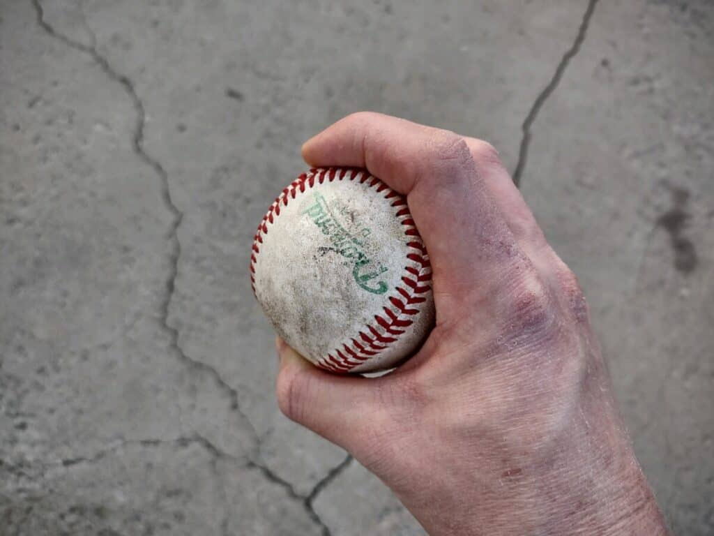 Sinker Pitch With Fingers Over Seams - Side View