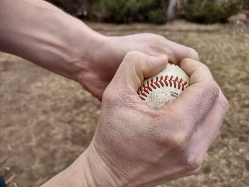 Pitcher Rubbing Baseball